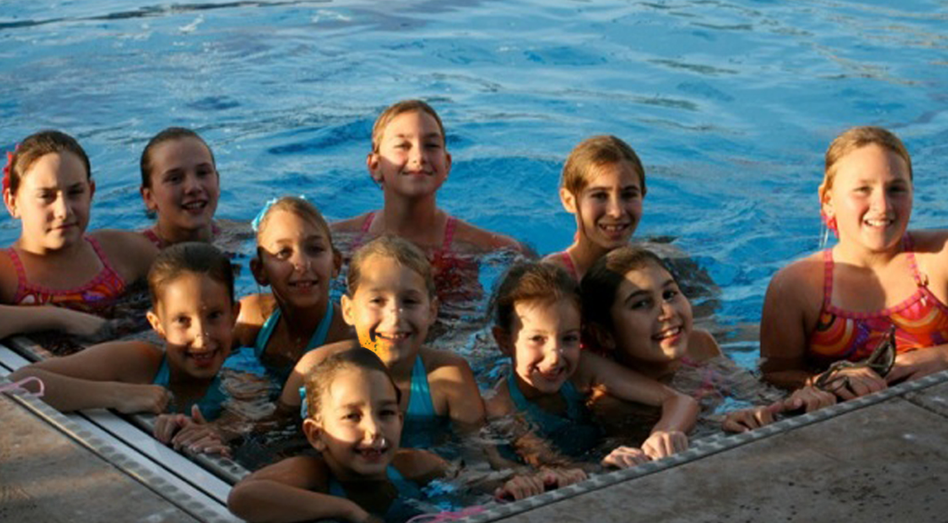 This program is a non-competitive introduction to synchronized swimming. Our Saturday Swimmers program is for kids who need to work on their strokes and have no or little experience in synchronized swimming. An athlete should be able to swim two laps of crawl stroke and breaststroke as well as feel comfortable swimming in the deep end of a pool.  Saturday swimmers will learn synchro skills such as ballet leg, somersaults, sculling, and eggbeater and will perform simple routines. Bring a friend and come out to begin learning this amazing Olympic sport.